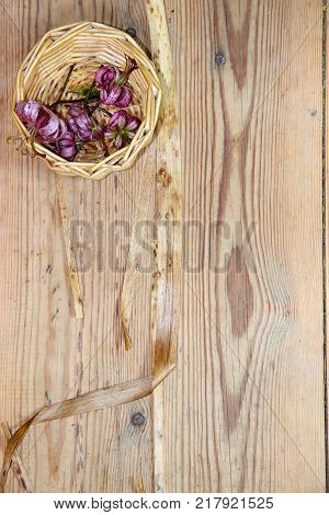 Dried Wilted Lilies On A  Dark Wooden Surface