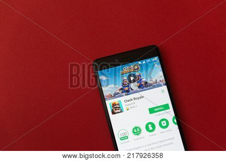 Los Angeles, december 11, 2017: Smartphone with Clash Royale game application in google play store on red background