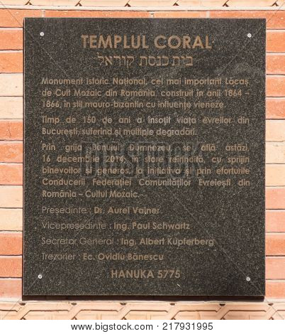 Bucharest Romania October 10 2017 : A commemorative marble plaque on the wall at the entrance to the synagogue Coral in Bucharest city in Romania