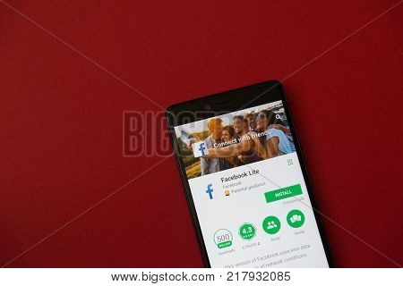 Los Angeles, december 11, 2017: Smartphone with Facebook lite application in google play store on red background
