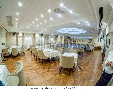 MOSCOW RUSSIA - MAY 31 2017: Interior of luxury restaurant Aragvi in Moscow Russia on May 31 2017. Restaurant was founded in 1930 by USSR NKVD minister Lavrentiy Beria. Now it has 9 halls.