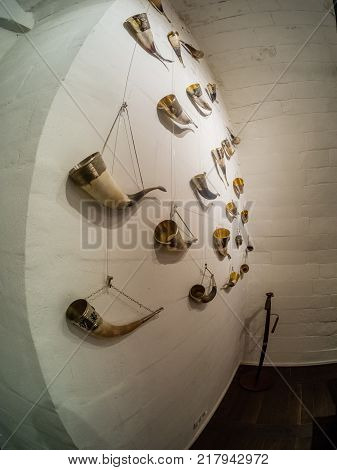 MOSCOW RUSSIA - MAY 31 2017: Collection of vintage drinking horns in restaurant Aragvi in Moscow Russia on May 31 2017. Restaurant was founded in 1930 by USSR NKVD minister Lavrentiy Beria.
