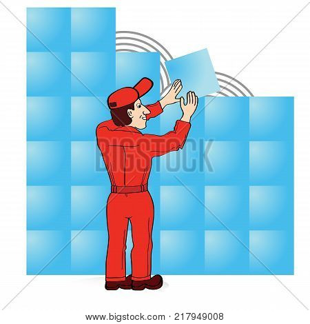 Builder in red boiler suit laying tiles