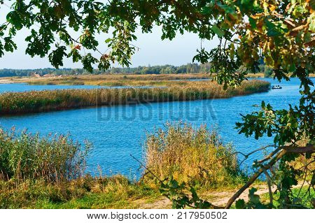 lake or pond for fishing, the fishermen on the boat, the scenery is beautiful pond