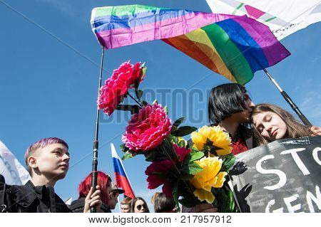 Young People With The Flag Of The Rainbow