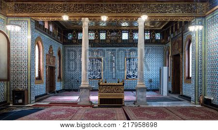 Cairo, Egypt - December 2, 2017: Interior of public mosque of Manial Palace of Prince Mohammed Ali Tewfik with wooden golden ornate ceilings