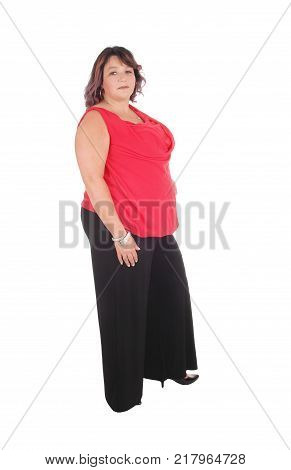 Beautiful full sized woman standing in a red blouse and black trousers in profile isolated for white background