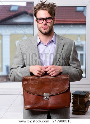 Serious man or professor with bristle in nerd glasses. Man with briefcase isolated on white background. Nerd wearing classic jacket. Education and work concept. poster