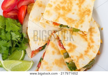 Chicken quesadilla dish on wooden rustic table