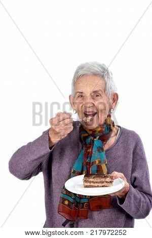 Senior Woman Playing Cake;on White