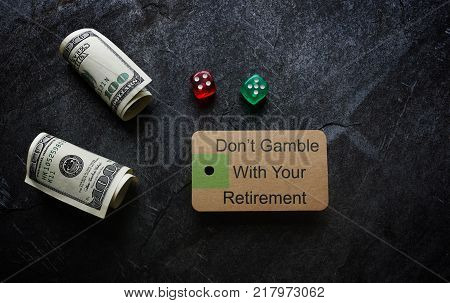 Don't Gamble With Retiremant message on paper tag with dice and cash