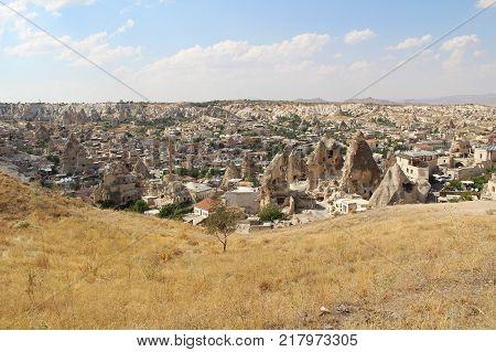 Goreme village Turkey. Rural Cappadocia landscape. Stone houses in Goreme Cappadocia. Countryside lifestyle.