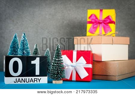 January 1st. Image 1 day of january month, calendar at christmas and new year background with gifts and little Christmas tree.