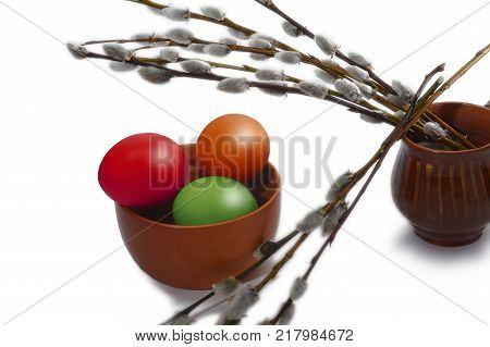 Several osier of willow and colored Easter eggs