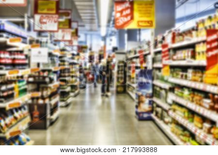 Background supermarket. Background blur. The concept: consumerism, trade, sale. Abstract blur and defocused convenience and supermarket store interior for background