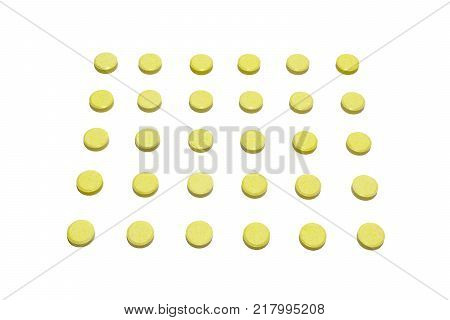 tablets yellow colored with no stripes for division arranged in slender lines. Isolated
