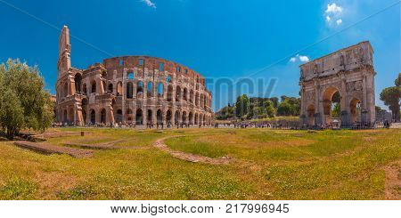 Panorama of The Arch of Titus and Colosseum or Coliseum, also known as the Flavian Amphitheatre, the largest amphitheatre ever built, in the centre of the old city of Rome, Italy.