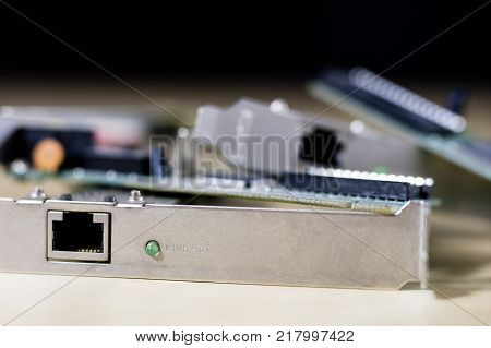 Old Network Cards For Desktop Computers. Network Cards With Rj44 Connector. Wooden Table.