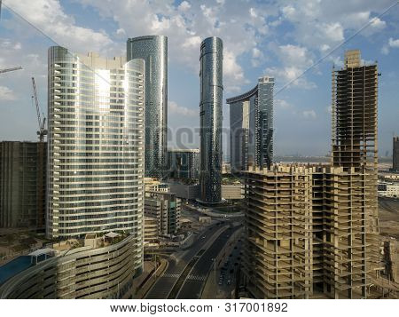 Top Aerial Drone Shot Of City Skyscrapers At Sunset - Al Reem Island Sun, Sky And Gate Towers In Abu