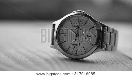 Watch Time Clock On Wood Table