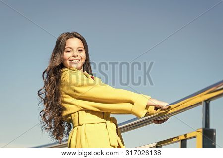 Growing Longer And Thicker Hair. Little Child With Stylish Long Brunette Hair. Fashion Look Of Hair