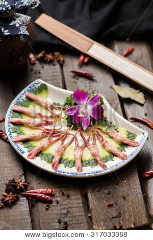 Fresh Duck Tongue With Cucumber Slices In A White Ceramic Dish