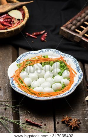 Well Done Quail Eggs In A White Ceramic Dish