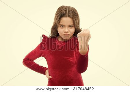 Dangerous Girl. Feel My Power. Girl Kid Threatening With Fist Isolated On White. Strong Temper. Thre