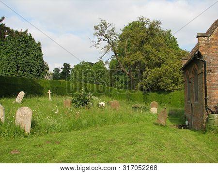 Graveyard Cross Headstone In Church Yard Grounds