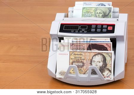 Old Deutsche Marks in a counting machine poster