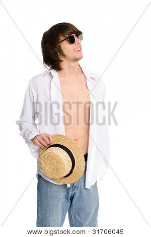 Smiling young man holding a straw hat