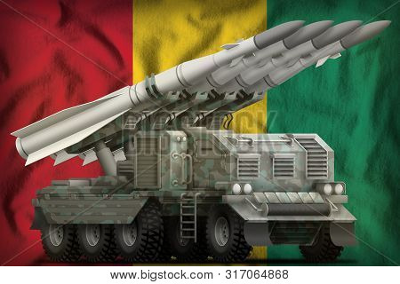 Tactical Short Range Ballistic Missile With Arctic Camouflage On The Guinea Flag Background. 3d Illu