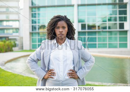 Confident Determined Businesswoman Posing Outside. Young Black Woman Wearing Formal Suit, Standing N