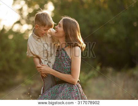 Happy Mom And Baby Together Smiling And Laughing In Nature. Concept Happy Family, Happy Children, Ha