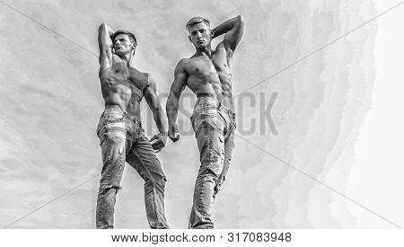 Sexy Torso Attractive Body. Denim Pants Emphasize Masculinity Sexuality. Men Twins Brothers Muscular