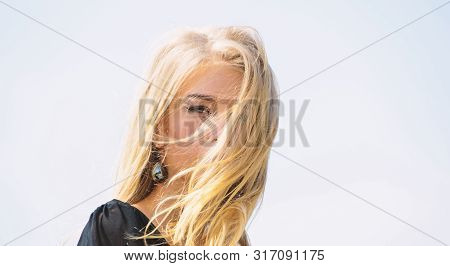 How To Take Care Of Bleached Hair. Girl Tender Blonde Makeup Face Sky Background. Bleaching Roots. H