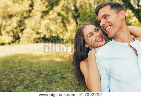 Outdoor Portrait Of Romantic Couple In Love Dating Outdoors At The Park On A Sunny Day. Happy Couple