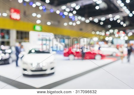 Abstract Blurred Image Of Cars Exhibition Show. Blurred Defocused Image Of Public Event Exhibition H