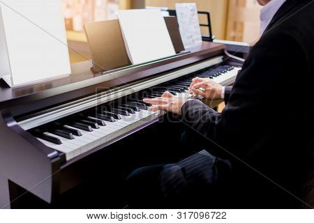 Close-up Of A Music Performer's Hand Playing The Piano. Side View Of Instrument Musical Tool. Close