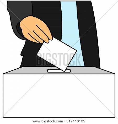 A Man Inserts A Ballot Paper Into The Ballot Box That Stands On The Table. The Voter Votes In The El