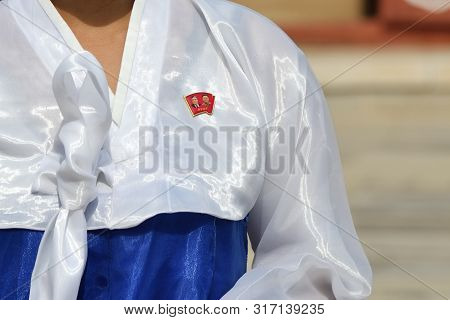 Kaesong, North Korea - May 5, 2019: Close-up Of A Kim Il Sung And Kim Jong Il Chest Badge On The Tra