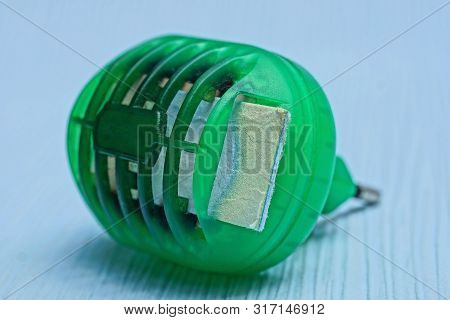 Old Green Plastic Fumigator Lies On A Blue Table