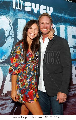 LOS ANGELES - AUG 12: Tatum Chiniquy, Ian Ziering at the Premiere Of SyFy's