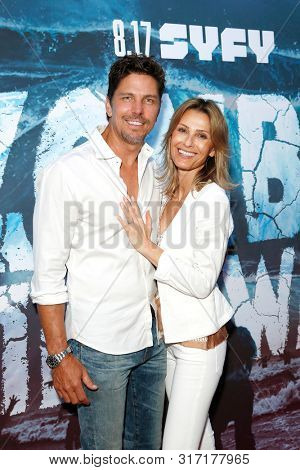 LOS ANGELES - AUG 12: Michael Trucco, Sandra Hess at the Premiere Of SyFy's