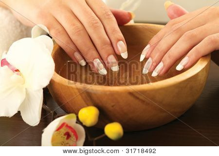 Woman's hands in bowl of water