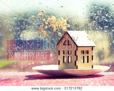 Home Is My Happy Place - Inspirational Motivation Quote. Wooden Toy House Model With A Tree Flowers