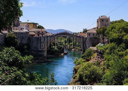 The Old Bridge In Mostar With Emerald River Neretva. Mostar, Bosnia And Herzegovina