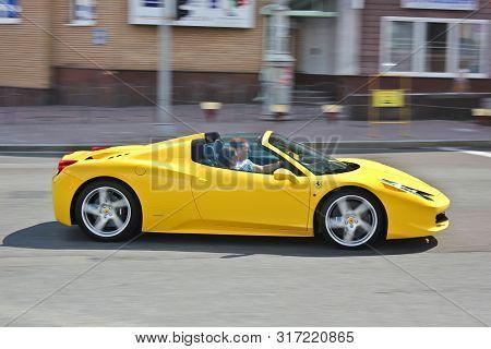 Ukraine, Kiev. June 25, 2013, Summer. Ferrari 458 Spider. Cabrio. Car In Motion