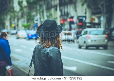 Woman In City Street Traffic. Woman City Life Lifestyle. City People. Busy People. Woman Walking On