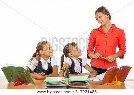 Girls at their desks have fun watching their beloved teacher poster